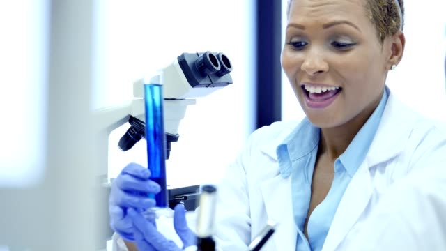 Confident African American female scientist discusses findings with research assistant video
