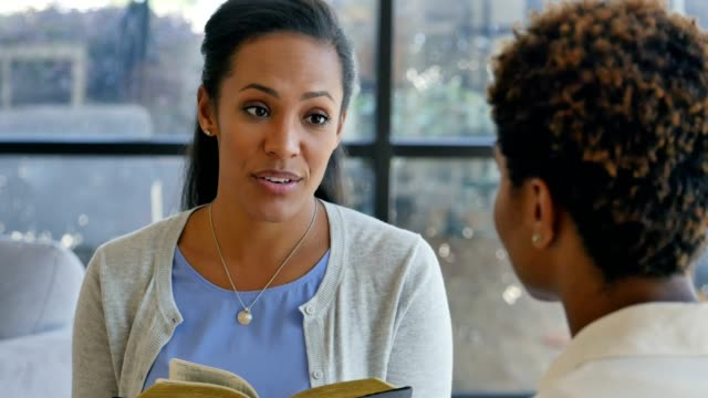 Confident African American woman leads a Bible study video