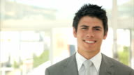 Confident businessman smiling in office video