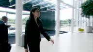 Confident businesswoman enters offices video