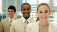 Confident businesswoman smiling with colleagues in office video