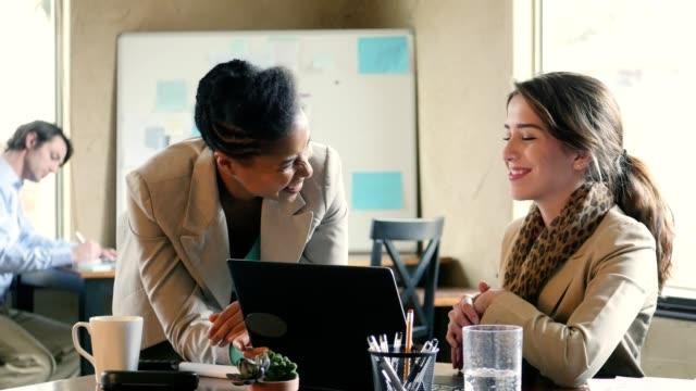 Confident female design professionals meet to discuss current project video