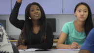 Confident Female Student Interacts in Classroom Setting video