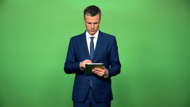 Confident male using tablet video