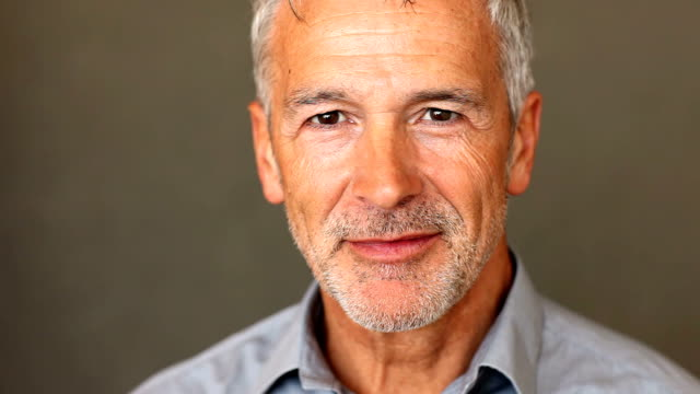 Confident mature man smiling at you video