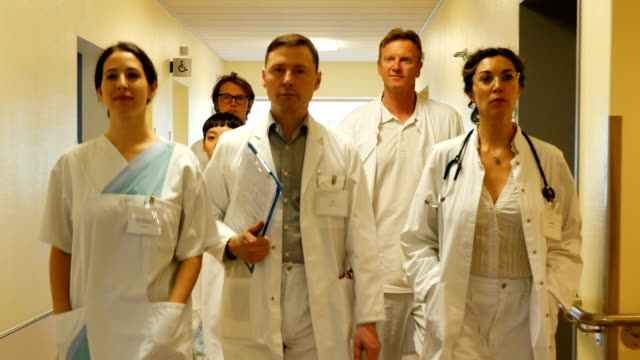 Confident medical team walking in corridor video