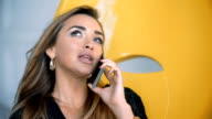 Confident smiling businesswoman talking on the phone video