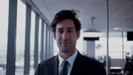 Confident young businessman in office video