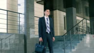 Confident young businessman waiting for his colleagues to talk video