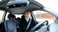 Confident young man drive compact car, passenger compartment interior, dashboard view video