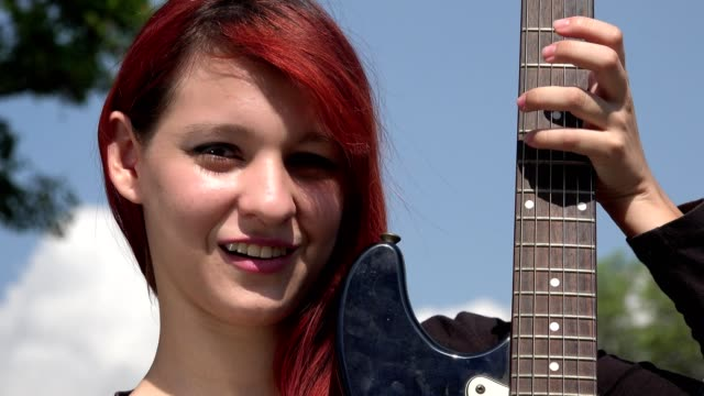 Confused Teen Redheaded Female With Guitar video