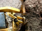 Construction: Bulldozer / Tractor Scoops Dirt, from Above video
