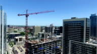 Construction Crane directly over Downtown Austin Texas building the new Jenga Building video