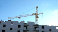 Construction crane, workers work in construction video