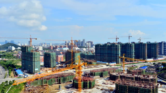 Construction cranes work at construction site video