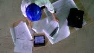 HD CRANE: Construction Engineer Examining The Blueprints video