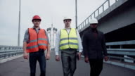 Construction engineers walking on highway ramp video