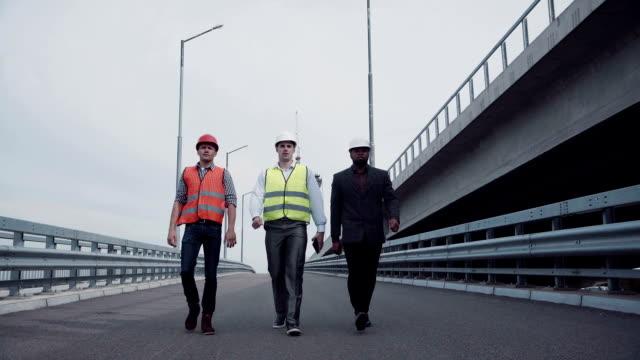 Construction engineers walking on highway ramp video