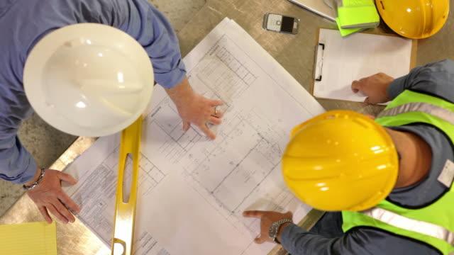 Construction Industry, contractors look over blueprints video