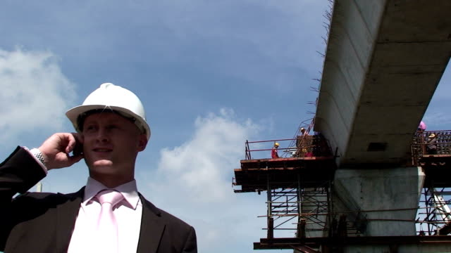 Construction manager on mobile phone. video