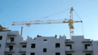 Construction of apartment houses. Crane, workers video