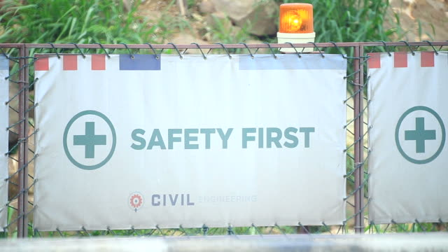 Construction safety barriers with warning plate and blinking lights video