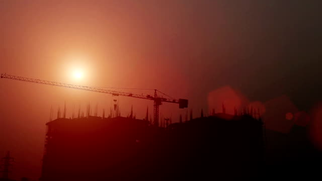 Construction site silhouette in the night video