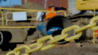 Construction site.Worker descending into a trench video