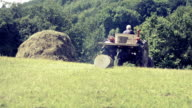 Construction Timber pulled by Tractor, vintage video