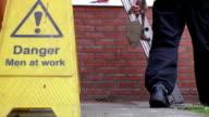 Construction worker climbing up the ladder video