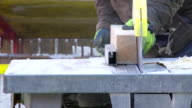 Construction Worker Cutting Squared Lumber CU video