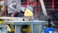 Construction Worker Cutting Squared Lumber MS video