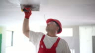 Construction worker finishing a ceiling. video
