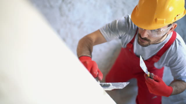 Construction worker finishing a wall. video