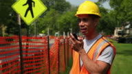 Construction worker giving directions video