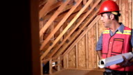 Construction worker holding plans video