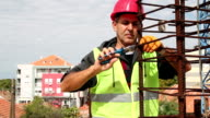 Construction Worker in Action With Combination Pliers video