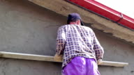Construction Worker Leveling Cement Render video