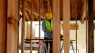Construction worker measuring before cutting video