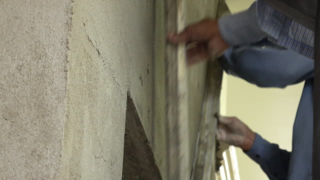 construction worker plaster cement wall, 4k video
