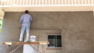 construction worker plaster cement wall video