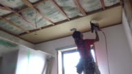 Construction worker remodeling home video