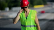 Construction worker talking on the phone video