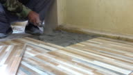 construction worker tiling ceramic tiles floor, dolly shot 4k video