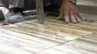 construction worker tiling floor, dolly shot 4k video