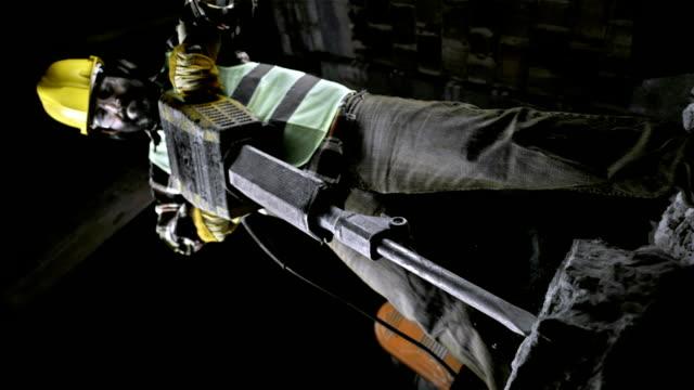 Construction Worker Using A Jackhammer (Super Slow Motion) video