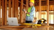 Construction worker using digital tablet video
