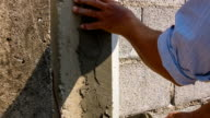 Construction workers are plaster pillars and walls video