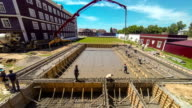 Construction workers pour the foundation, reinforcement and formwork. Kazakhstan, May 2016 - FullHD Timelapse video