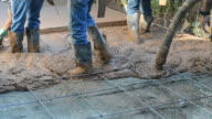 Construction Workers Pouring a Cement Driveway video